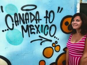 image of janine devault in front of street art