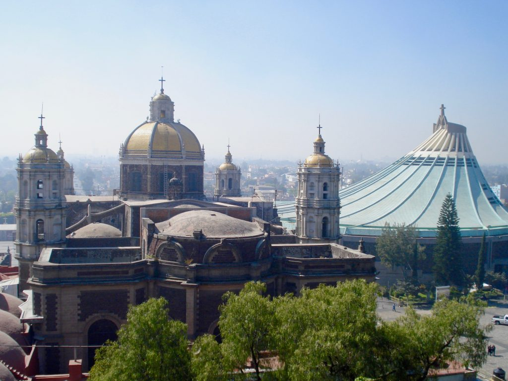 Each year, millions of people travel to the Basilica de Guadalupe (pictured here) to celebrate the die de la Virgen de Guadalupe.