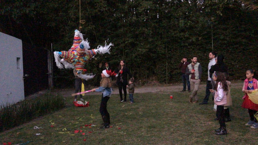 Las posadas are a Mexican tradition that involves singing traditional verses. After the singing is over, the party begins, including piñatas