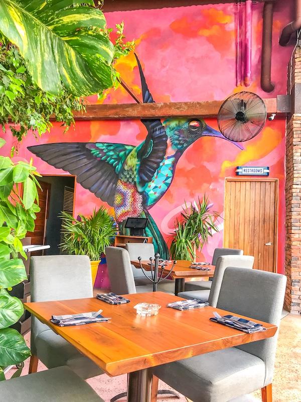 Patio 8 in Playa del Carmen will draw you in with it's gorgeous mural!