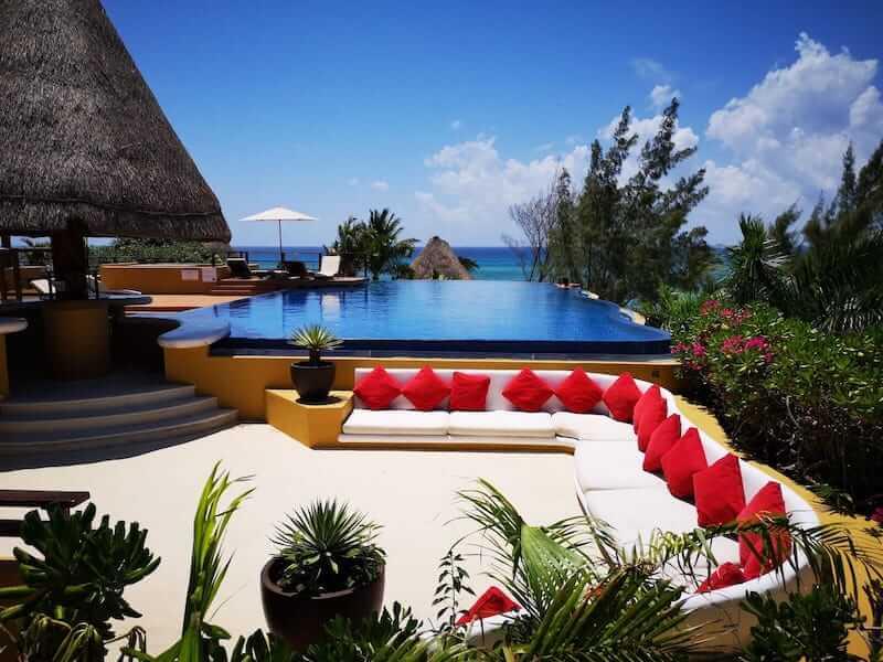 condo complex with pool by the ocean in Playa del Carmen, Mexico