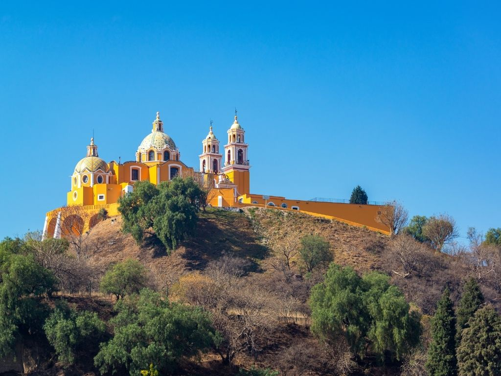 Cholula's famous cathedral, Nuestra Señora de los Remedios, sits on top of the world's largest pyramid, which is only partially excavated.