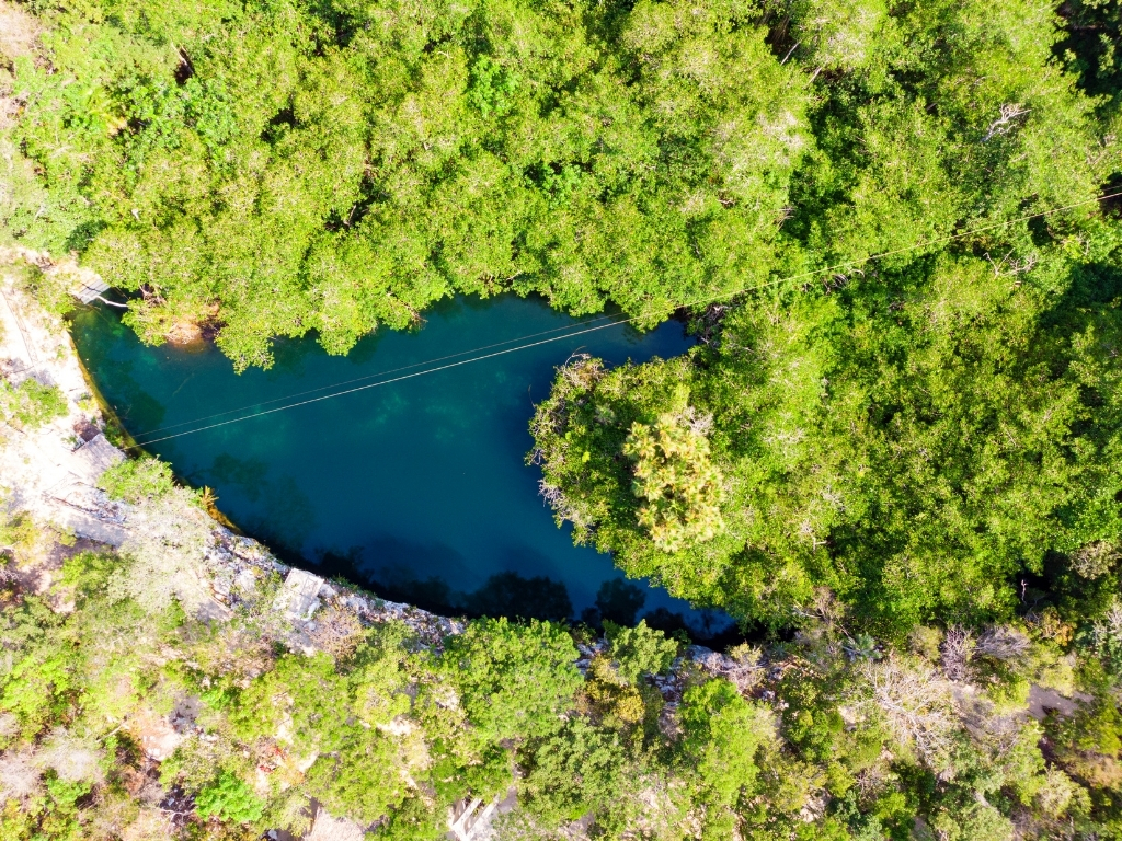 aerial view of Cenote Jaguar, another cenote found within Parque Dos Ojos.